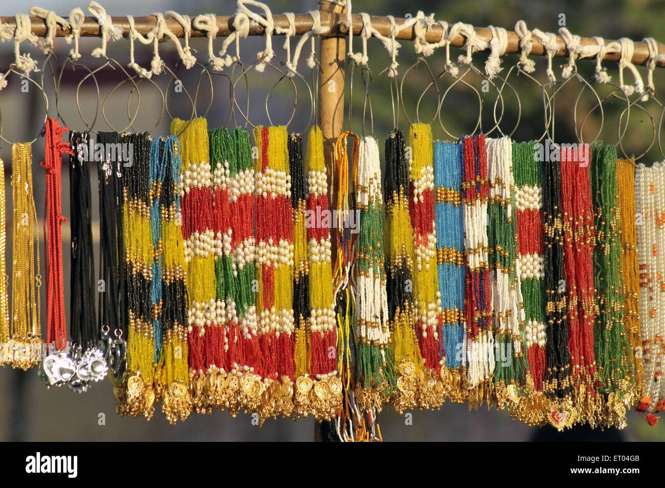 Cheap imitation Jewellery in stall at Pushkar Rajasthan India - Stock Image