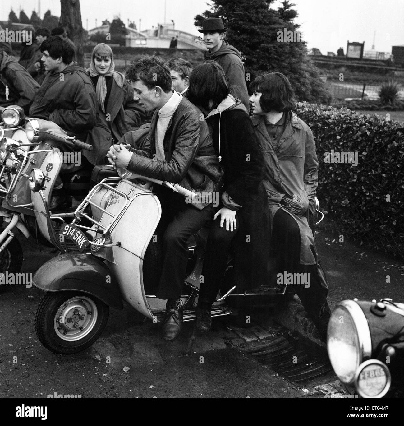 Mods gather on the sea front at Clacton on their scooters over the 1964 Easter weekend, which was marked by several - Stock Image