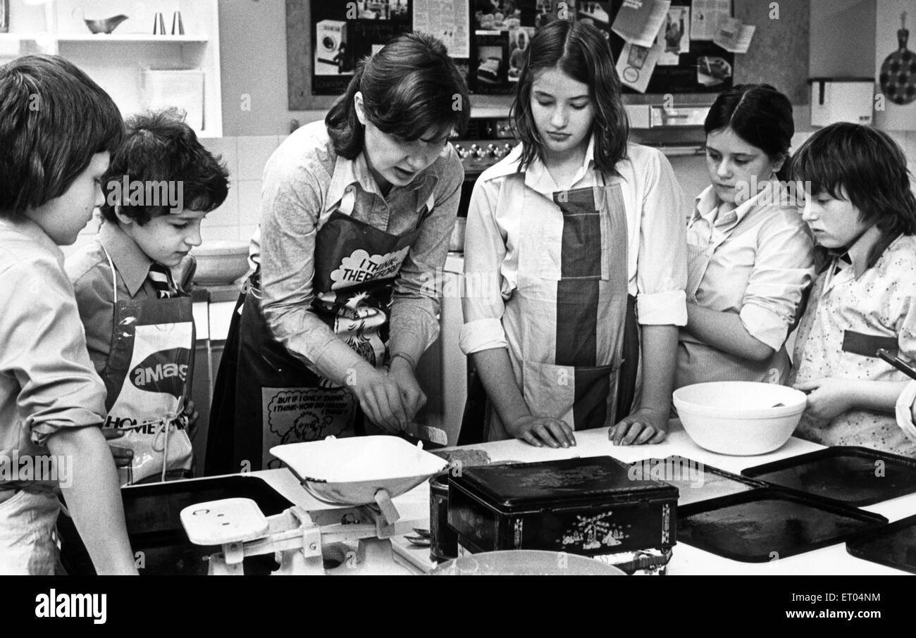 Mrs Sally Phillippe with some of her first year cookery class at Northfield School, Billingham. 23rd November 1978. - Stock Image