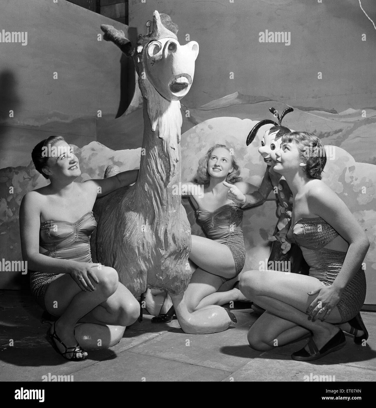 'Jimpy' a Daily Mirror cartoon strip character featured at Morecambe Illuminations in Lancashire, with showgirls - Stock Image