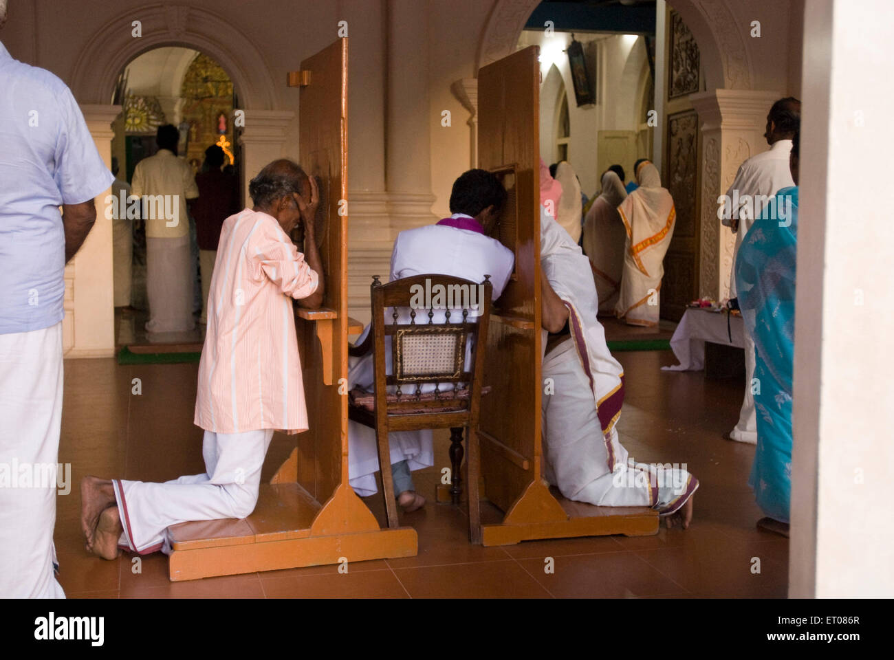 People making confession is Christian faith and practice Kerala India - Stock Image