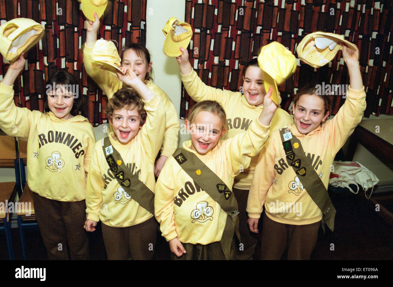 Members of the 1st Billingham Brownie pack celebrating getting a cash grant to be spent on tables and chairs and - Stock Image