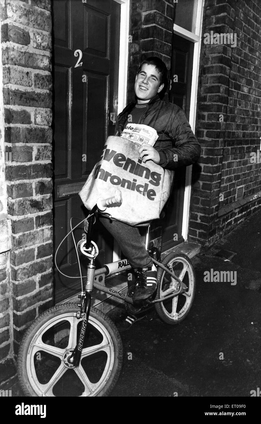 Paperboy Stephen bikes it round his round. 15th October 1983. - Stock Image
