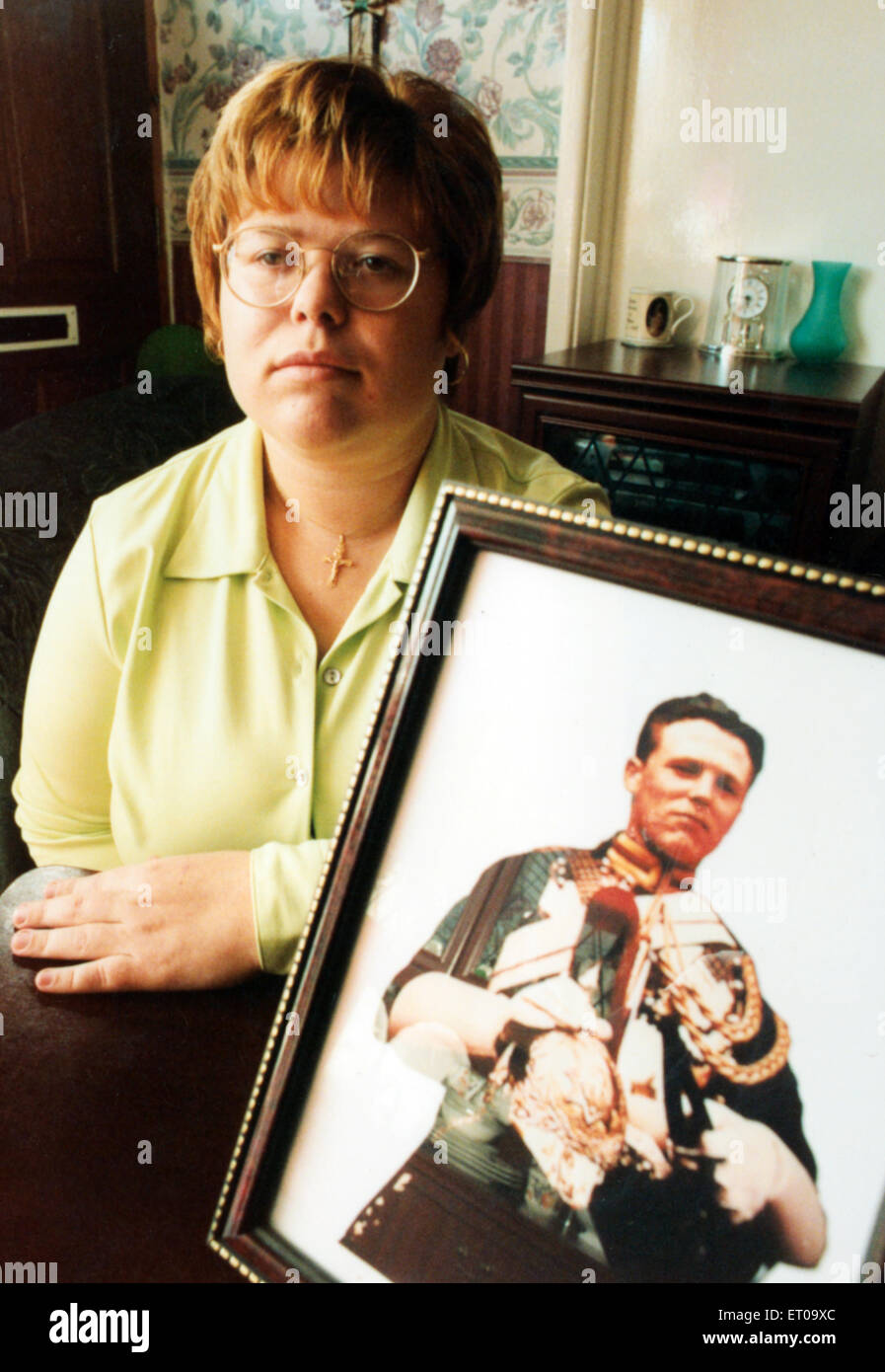 Sarah Jane Young, aged 20, from Tonyrefail, with a photograph of her soldier father Jeffrey Young, killed in an - Stock Image