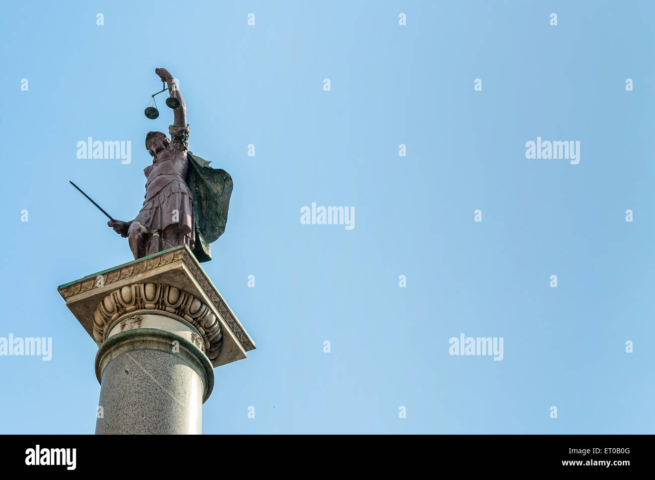 ancient Roman column with justice statue in Florence, Italy - Stock Image