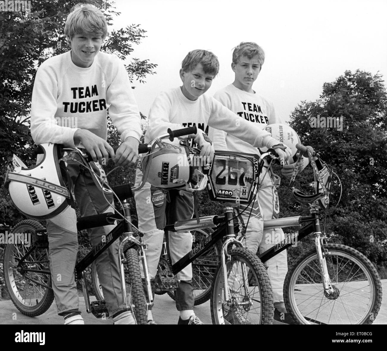 BMX bike fans, left to right, Jonathan Tucker, Richard Harrison and Kevin Hayes. All wearing Team Tucker jumpers. - Stock Image