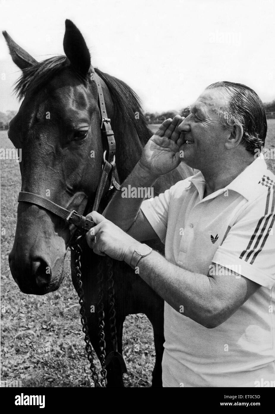 Liverpool manager Bob Paisley pictured at the stables of his close friend Frank Carr in Malton, Yorkshire. Here - Stock Image