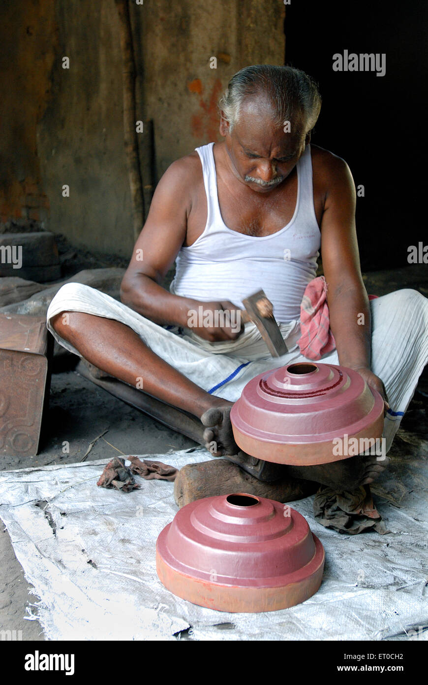 Engraver making copper gopura kalasam at  Kumbakonam ; Tamil Nadu ; India NO MR - Stock Image