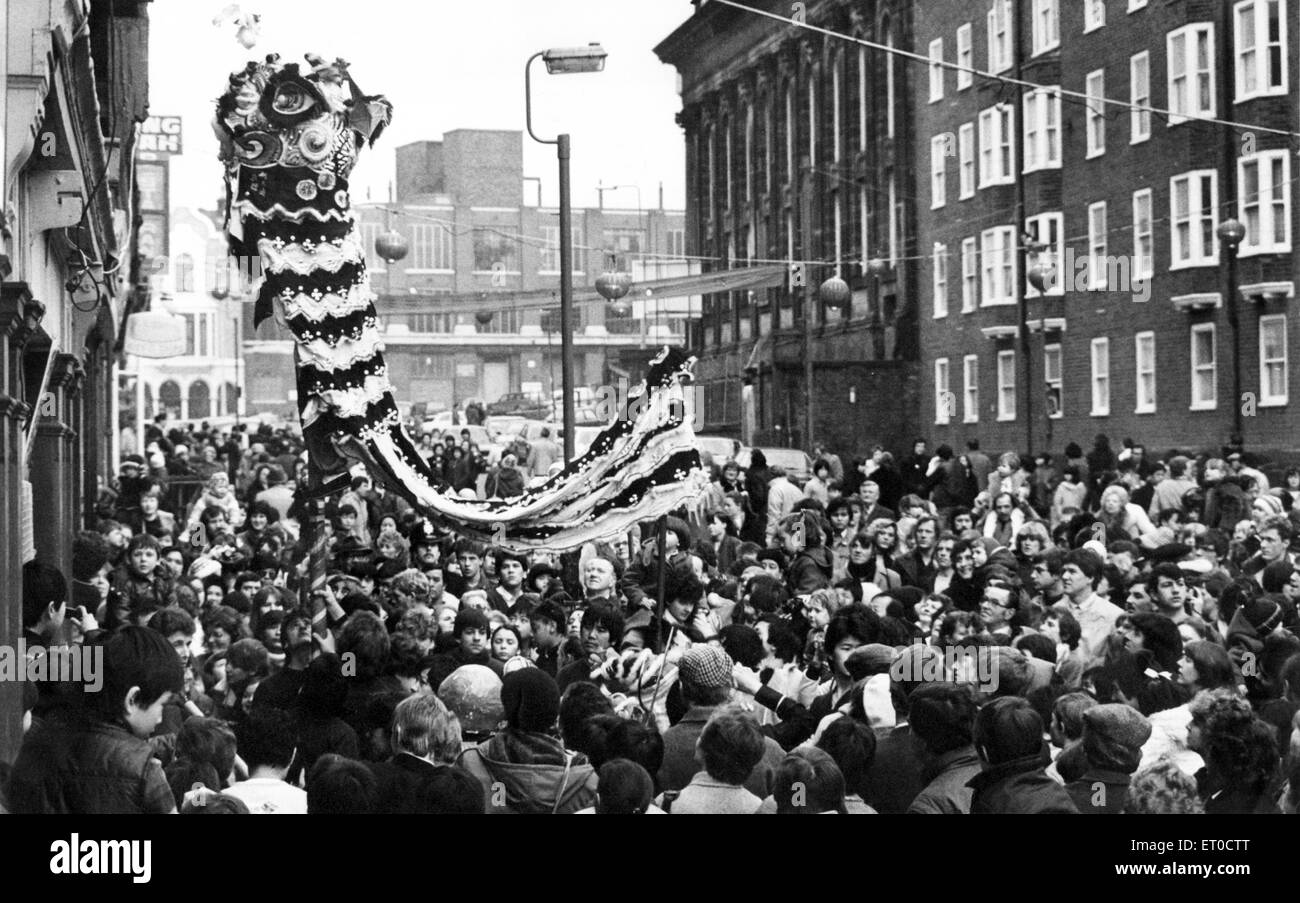 A large crowd watches traditional celebrations for the Chinese New Year, Liverpool, Merseyside. 13th February 1983. - Stock Image