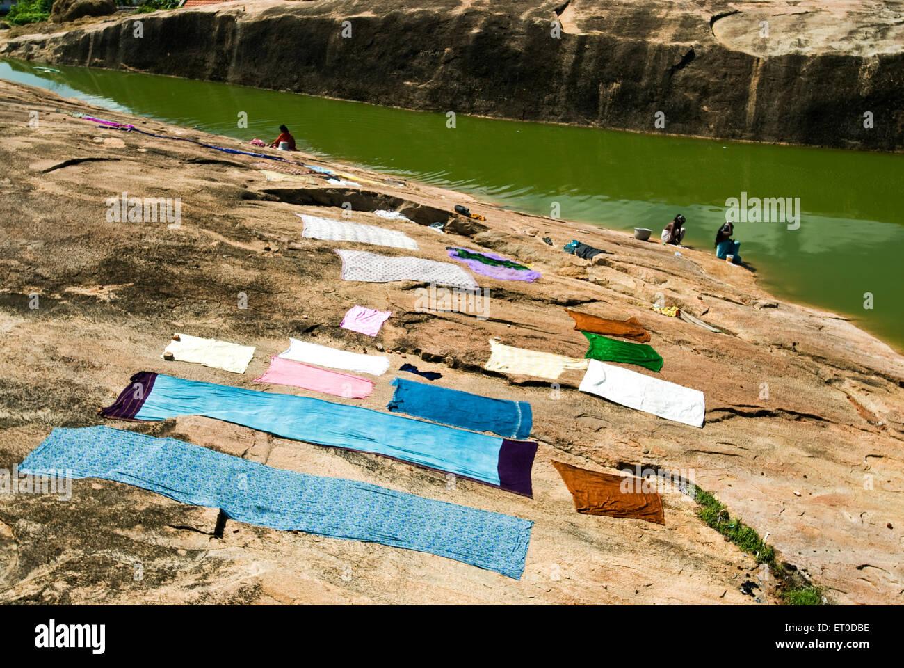 Narrow puddle in Kunnandarkoil ; Kundrandarkoil  ; Pudukkottai ; Tamil Nadu ; India - Stock Image