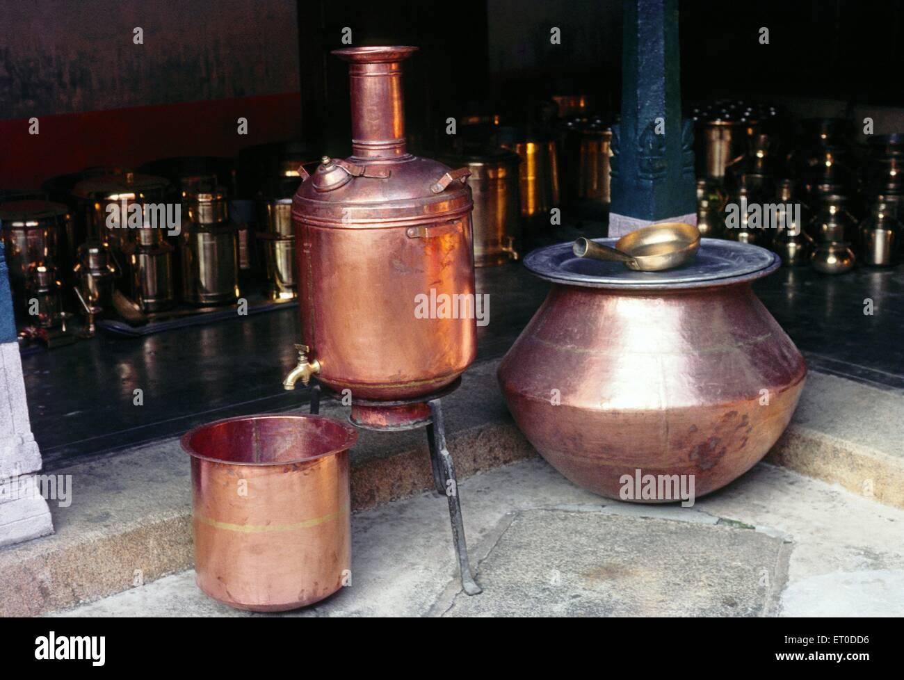 Copper water heater and huge round unda of nattukottai chettiar or nagarathar ; Chettinad ; Tamil Nadu ; India - Stock Image