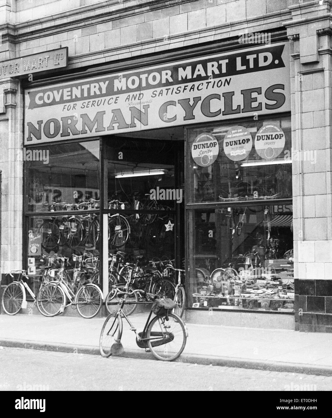 Coventry Motor Mart bicycle shop on White Friars Street Coventry circa 1957 - Stock Image