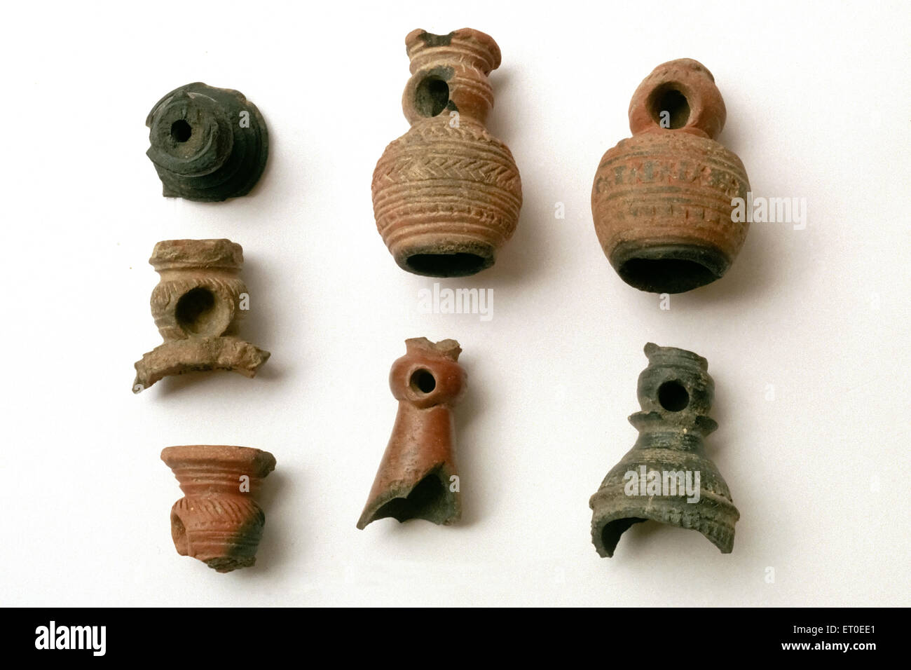 Terracotta smoking pipes  ; Tamil Nadu  ; India - Stock Image