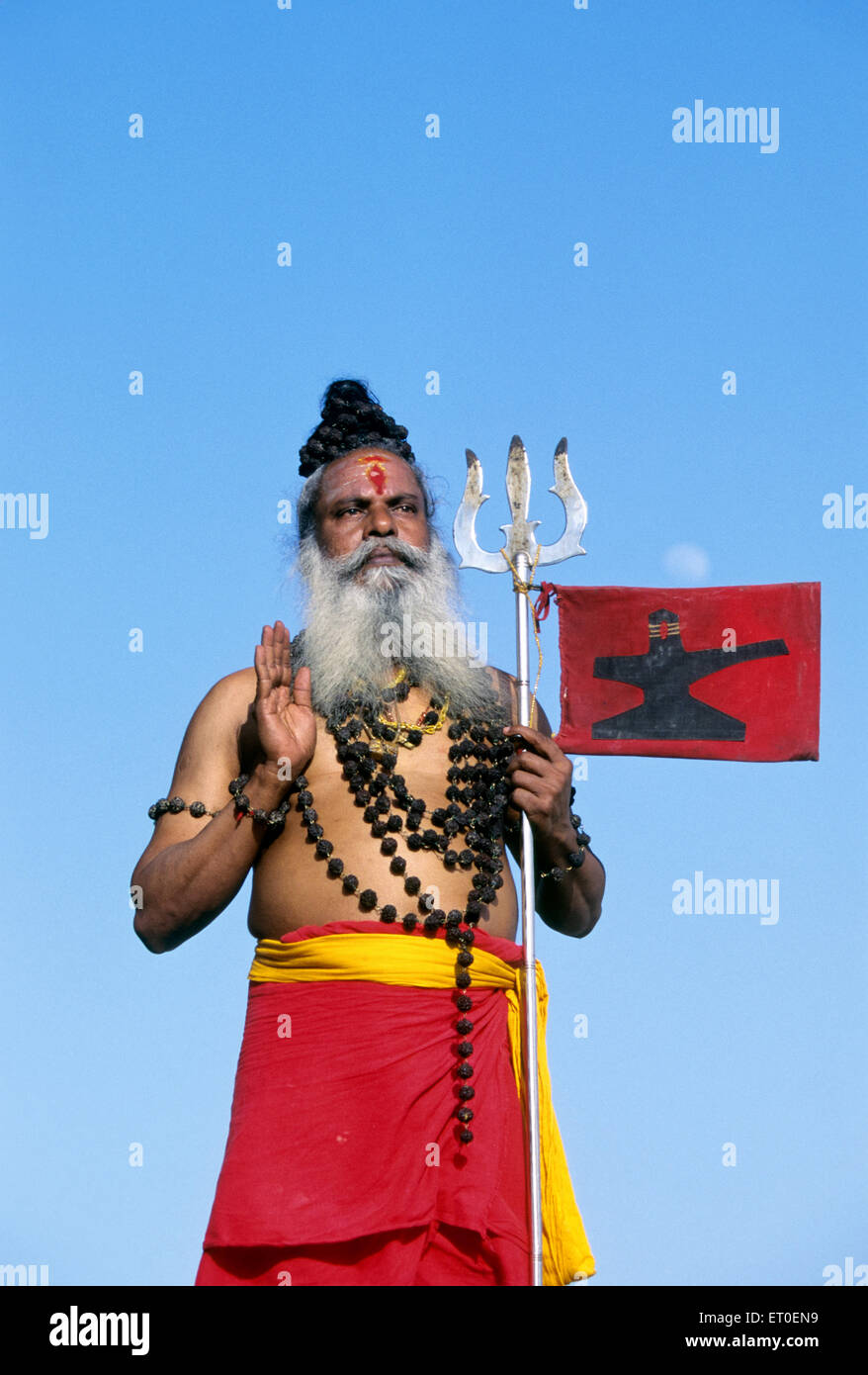 Sadhu in blessing posture holding trident ; Thanjavur ; Tanjore ; Tamil Nadu ; India MR#777A Stock Photo