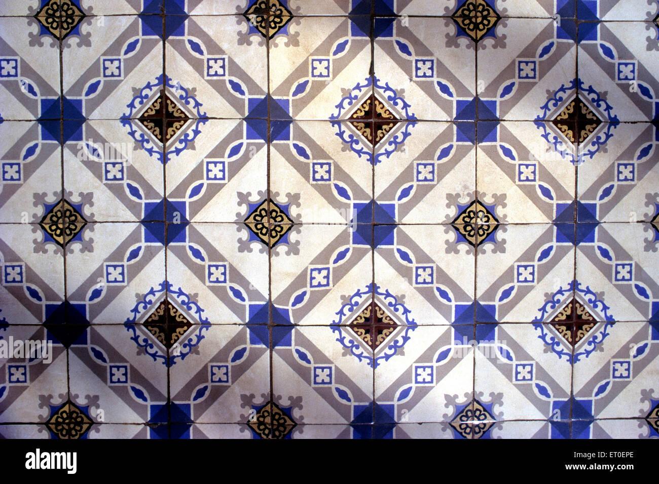 Floor tiles in Nattukottai Chettiar Nagarathar house of chettinad Tamil Nadu INDIA - Stock Image