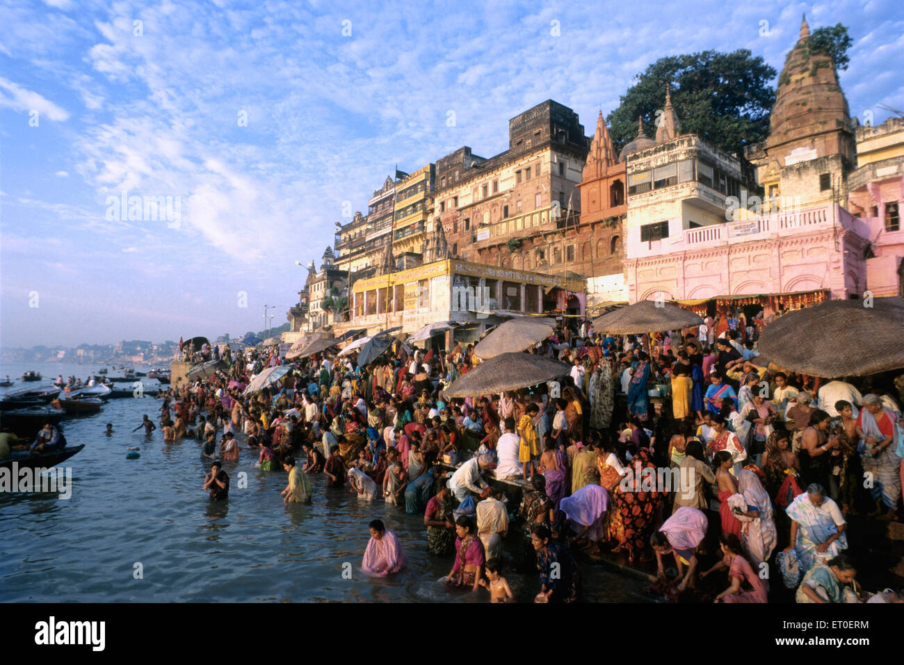ghats River Ganga at sunrise is considered auspicious and purifying Varanasi Uttar Pradesh INDIA - Stock Image