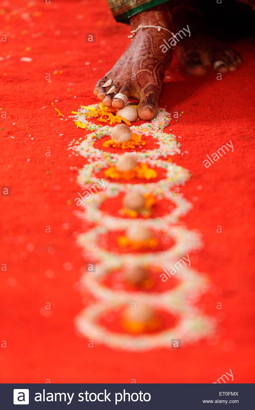 Indian Hindu wedding ceremony  ; bride walking symbolic seven steps  ; Bombay Mumbai  ; Maharashtra  ; India MR#748Y - Stock Image