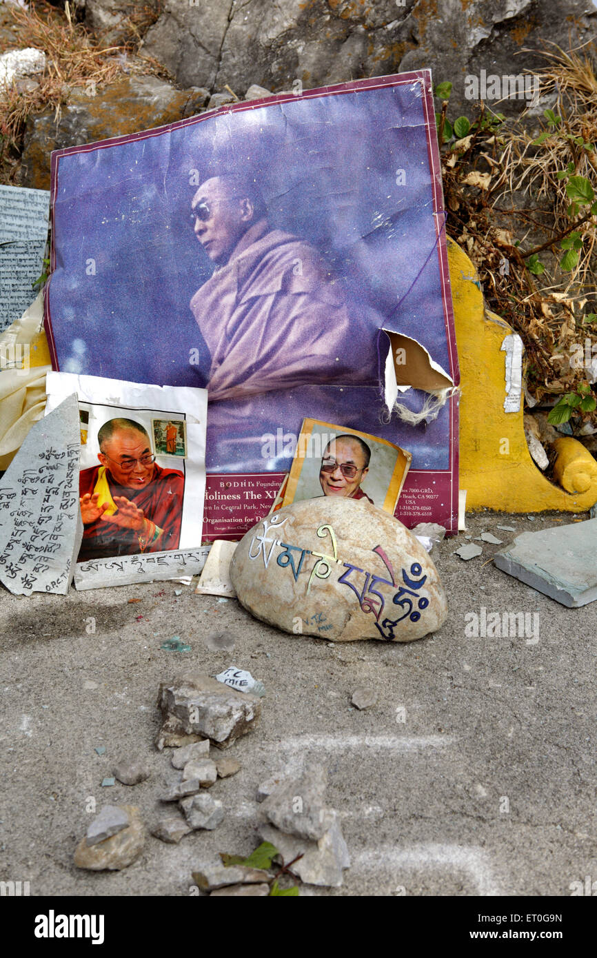 Photographs of Dalai Lama placed on rock ; Happy valley ; Mussoorie ; Dehradun ; Uttaranchal Uttarakhand ; India - Stock Image