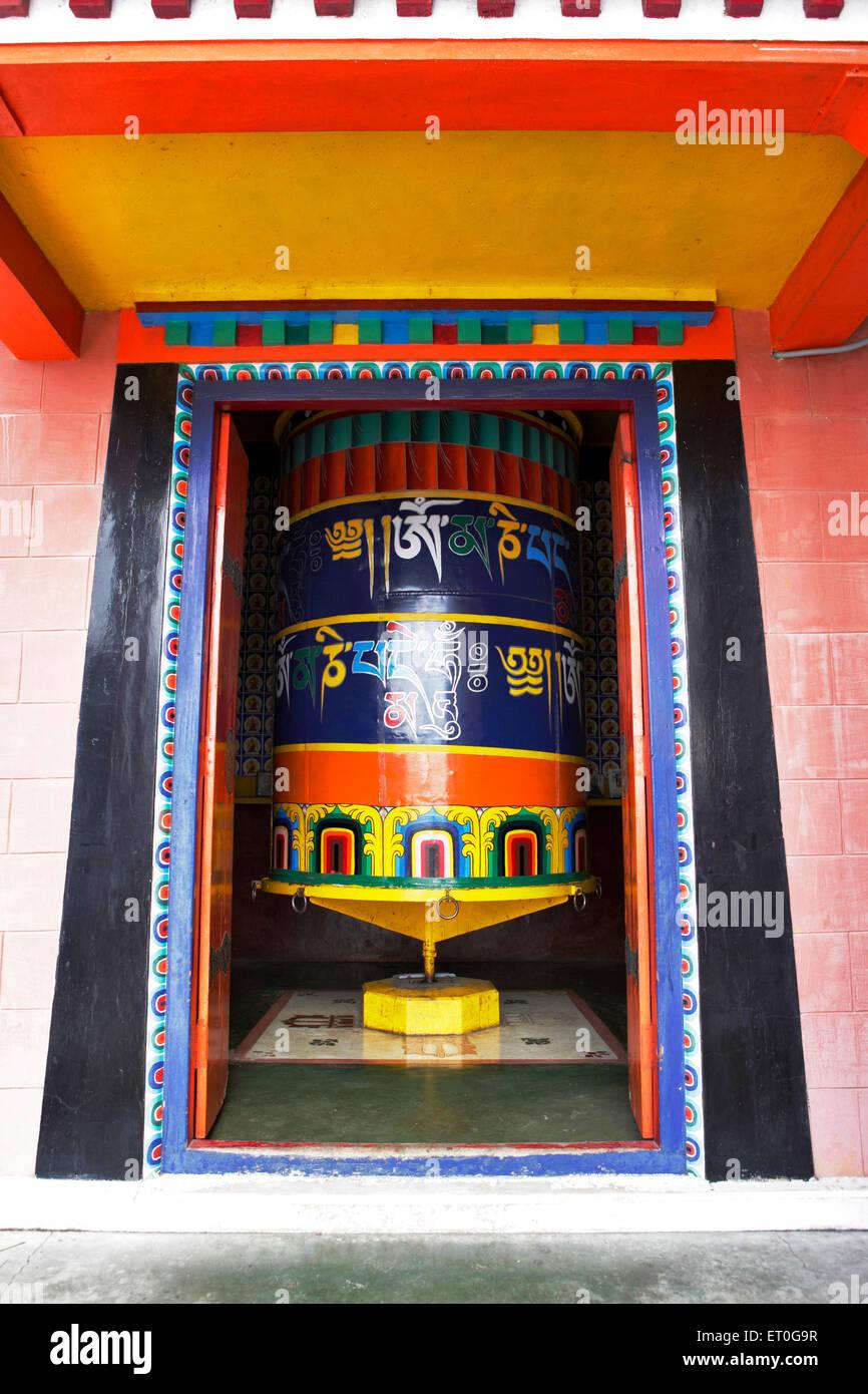 Written prayers or mantras on wheel in monastery ; Happy valley ; Mussoorie ; Dehradun ; Uttaranchal Uttarakhand - Stock Image