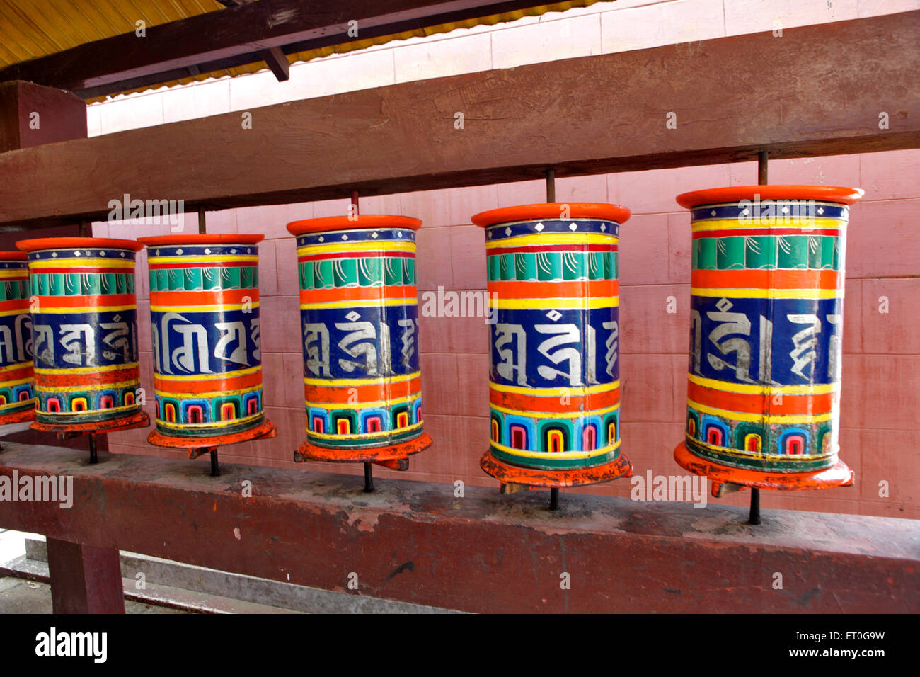 Written prayers or mantras on prayer wheel in monastery ; Happy valley ; Mussoorie ; Dehradun ; Uttaranchal Uttarakhand - Stock Image