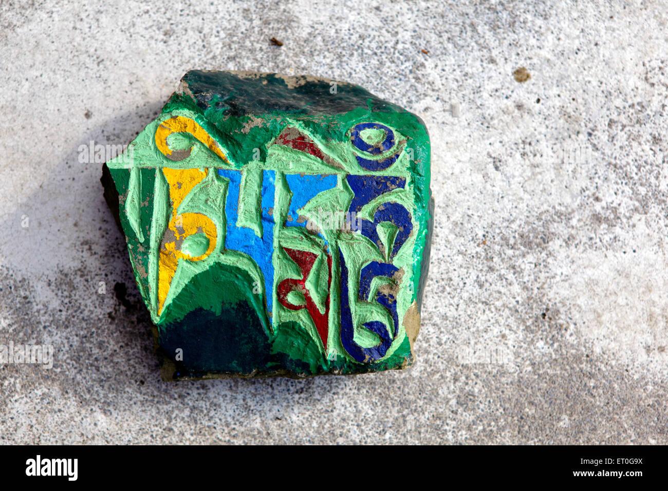 Written on prayers or mantras on stone in monastery ; Happy valley ; Mussoorie ; Dehradun ; Uttaranchal Uttarakhand - Stock Image
