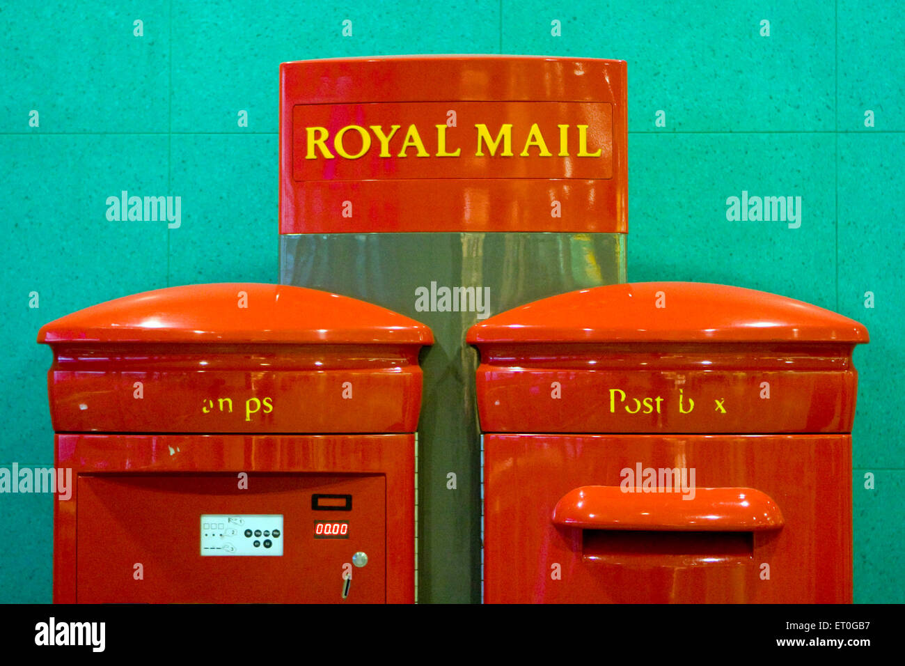 Royal mail stamp vending machine and postbox ; London ; UK United Kingdom England - Stock Image