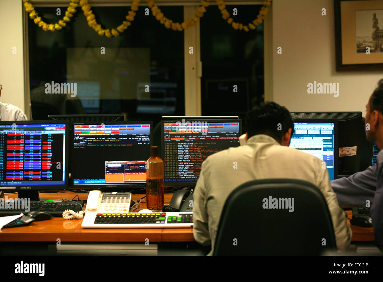 Stock brokers doing muhurat trading marking beginning of new trading year after Lakshmi puja performed in brokers - Stock Image
