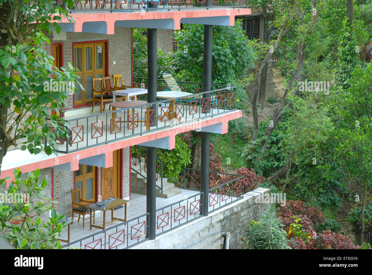 Two balconies of tourist resort with tables and chairs at Madikeri Madikery ; District Coorg ; Karnataka ; India - Stock Image