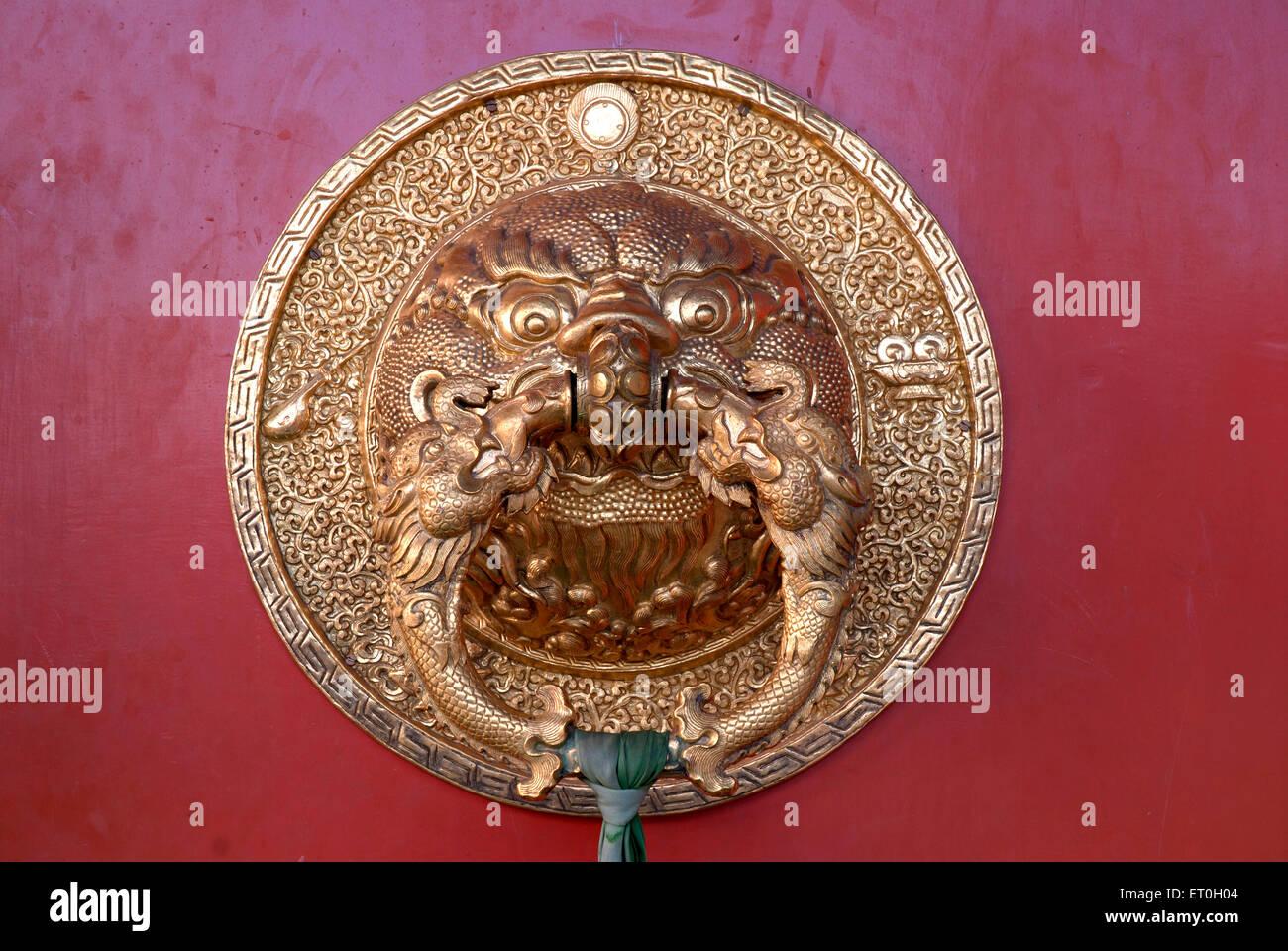 Dragon face door handle at Biggest Namdroling monastery at Kushal nagar District Coorg ; Karnataka ; India - Stock Image