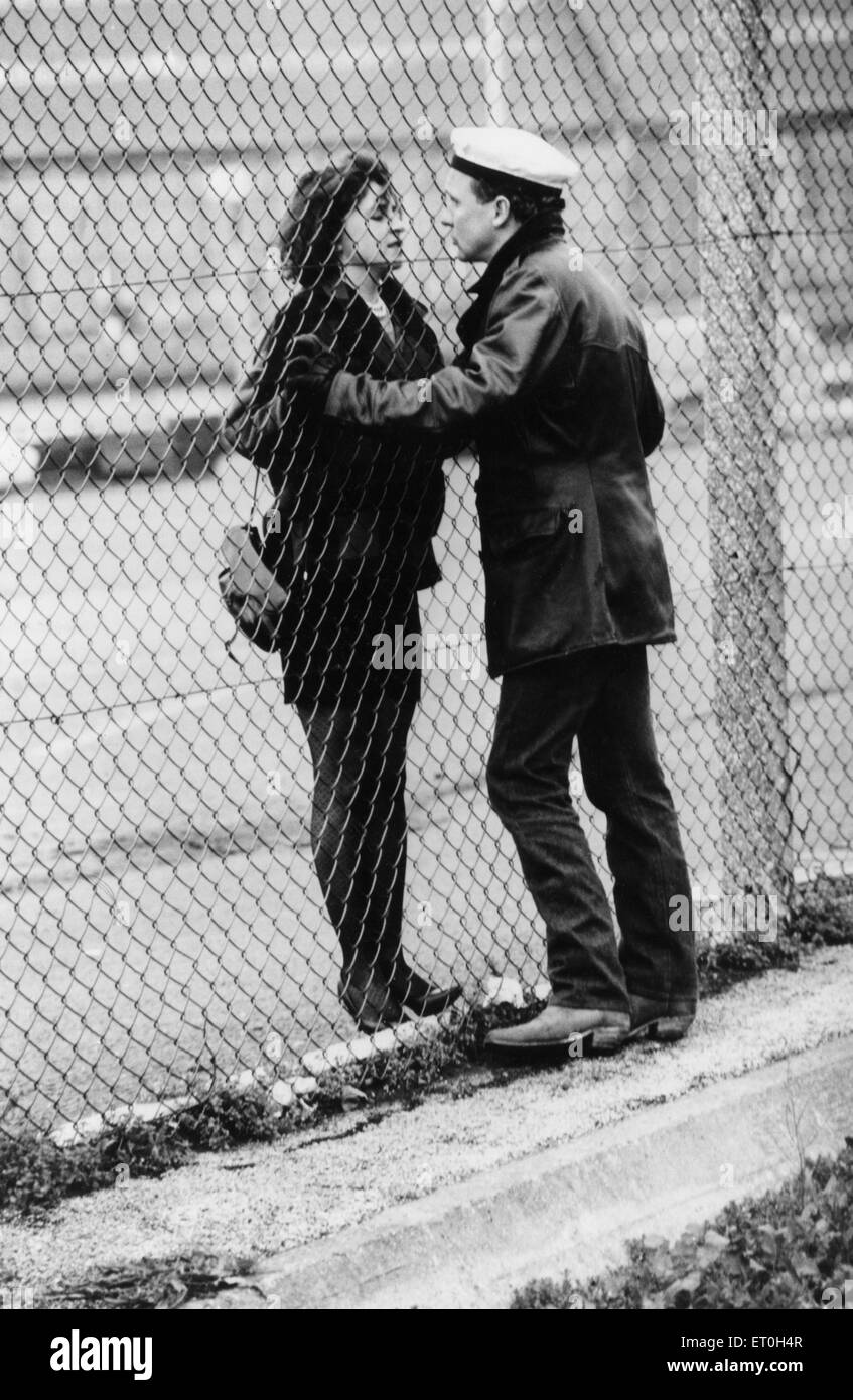Peter Firth and Alexandra Pigg seen here filming a scene for the film Letter to Brezhnev on location in Liverpool - Stock Image