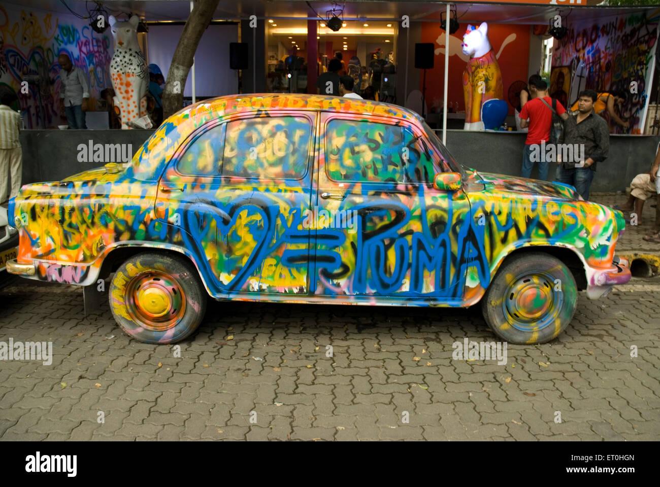 Colourful Ambassador car at Bandra west Mumbai Maharashtra India Asia - Stock Image