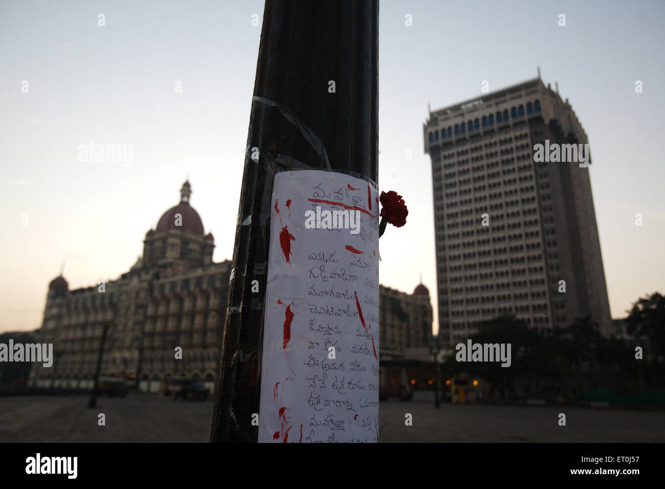 Condolence message written south Indian language red rose pole Gateway victims terrorist attack on 26th November - Stock Image