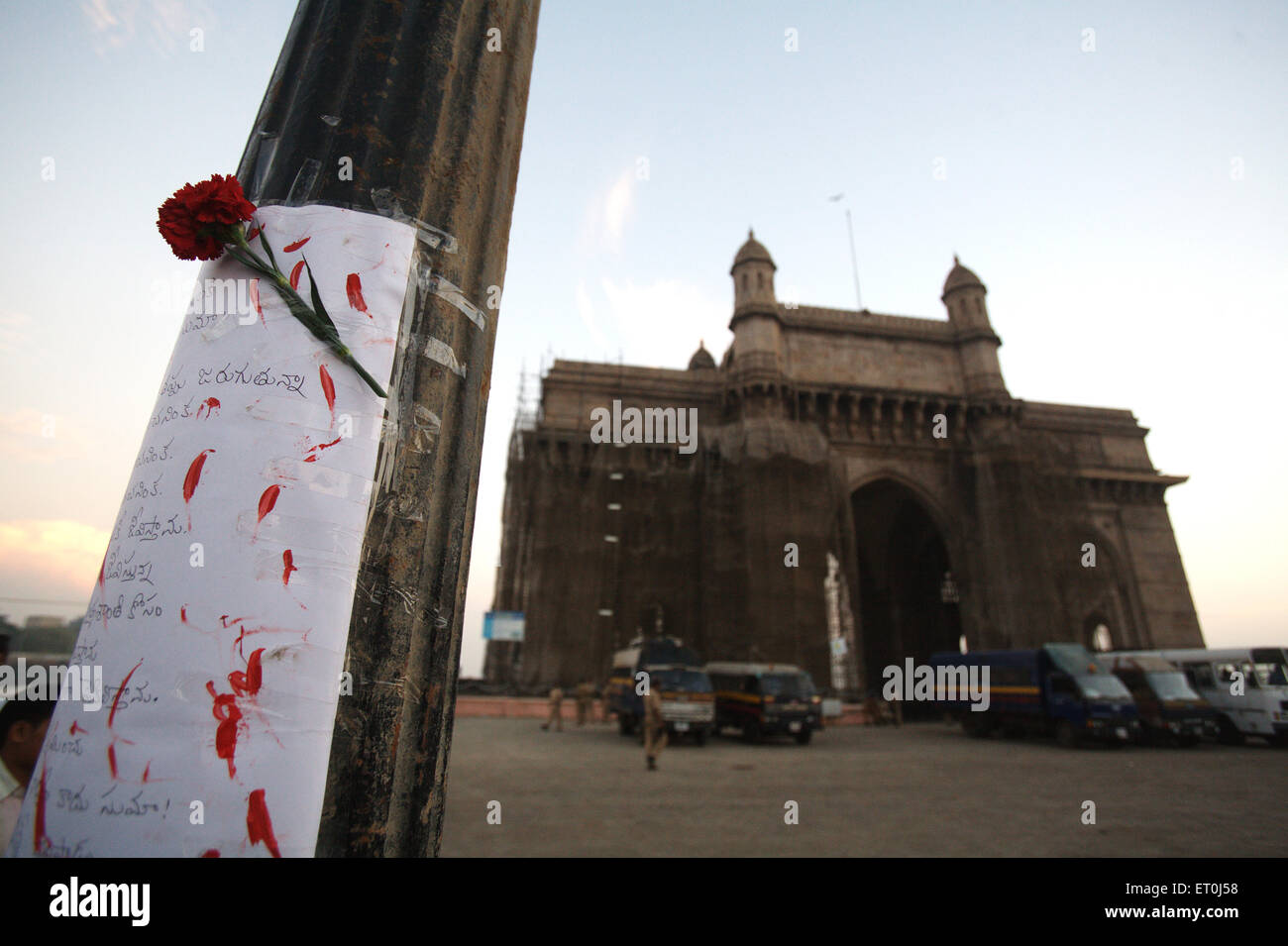 Condolence message written south Indian language red rose pole Gateway ; victims terrorist attack 26th November - Stock Image