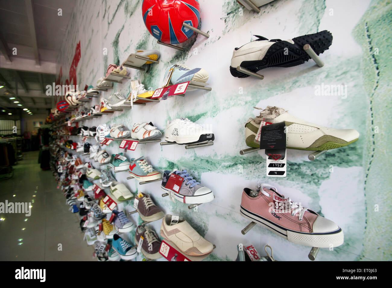 Shoes on display at Loot store located in Andheri ; Bombay Mumbai ; Maharashtra ; India - Stock Image