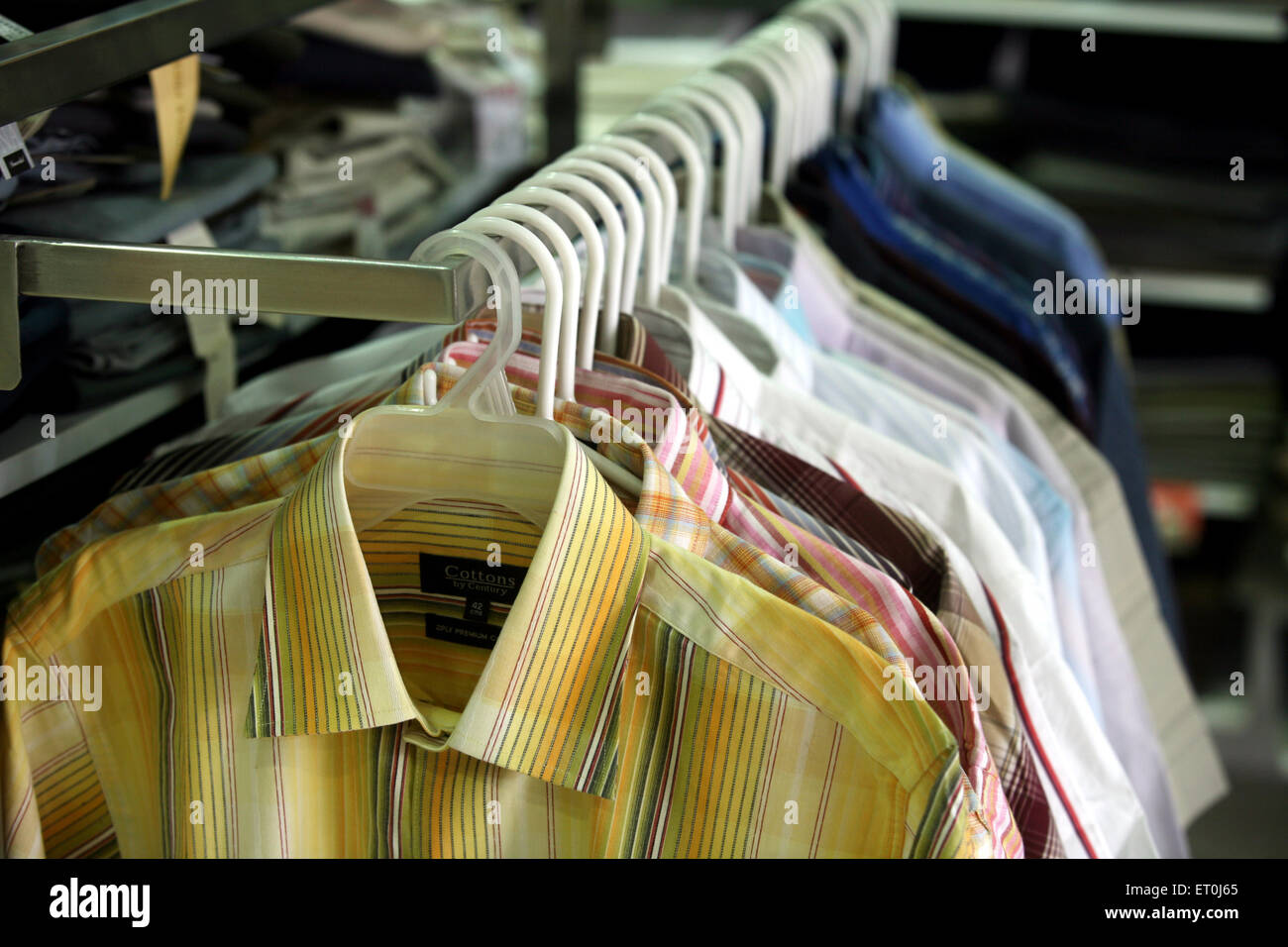 Shirts at the display in Loot store located in Andheri ; Bombay Mumbai ; Maharashtra ; India - Stock Image