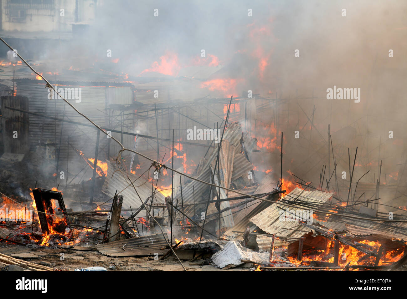 Site of fire which broke out at the Mhada colony situated at Versova ; Andheri ; Bombay now Mumbai ; Maharashtra - Stock Image