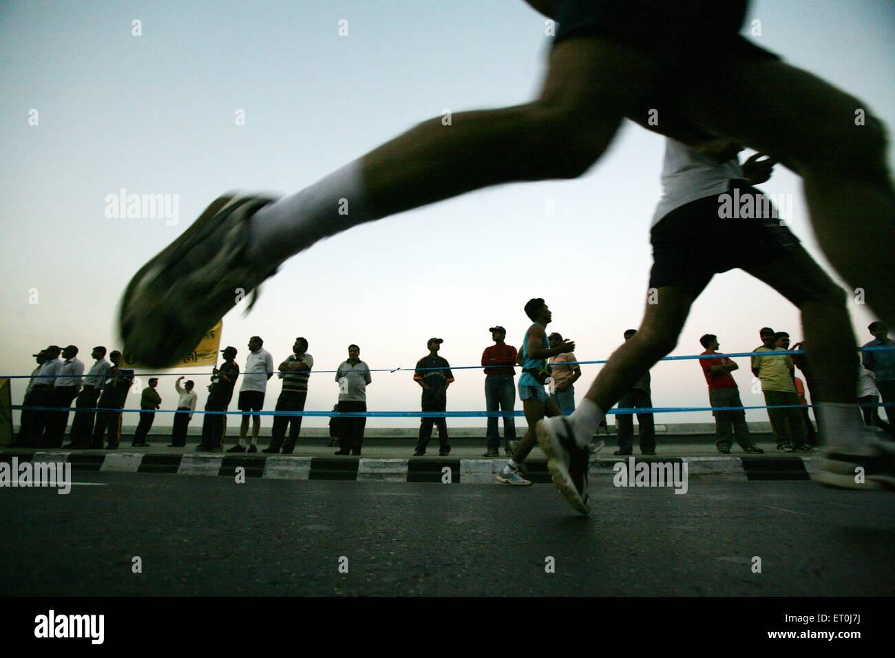 Participants running during the marathon organized in Bombay now Mumbai ; Maharashtra ; India - Stock Image