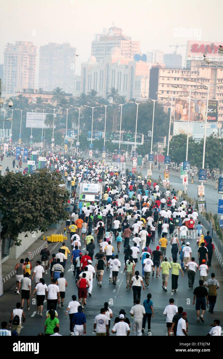 Participants running during the Mumbai marathon organized in Bombay now Mumbai ; Maharashtra ; India - Stock Image