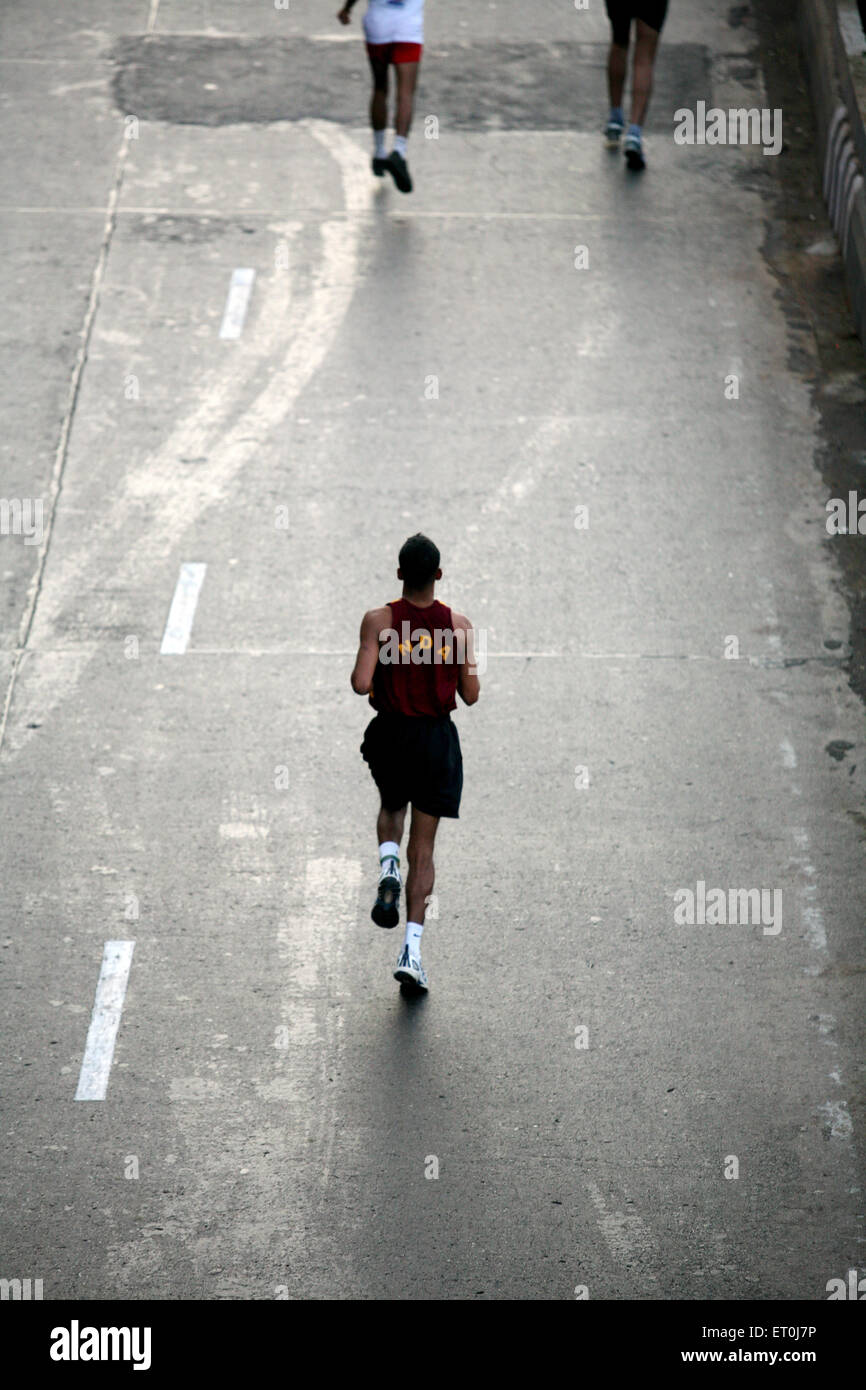 Participant running during the Mumbai marathon organized in Bombay now Mumbai ; Maharashtra ; India - Stock Image