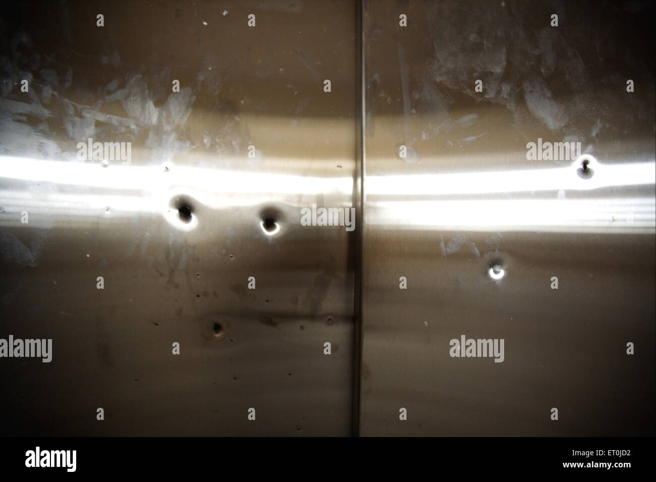Bullets marks on lift of Cama and Albless hospital in terrorist attack by Deccan Mujahedeen on 26th November 2008 - Stock Image