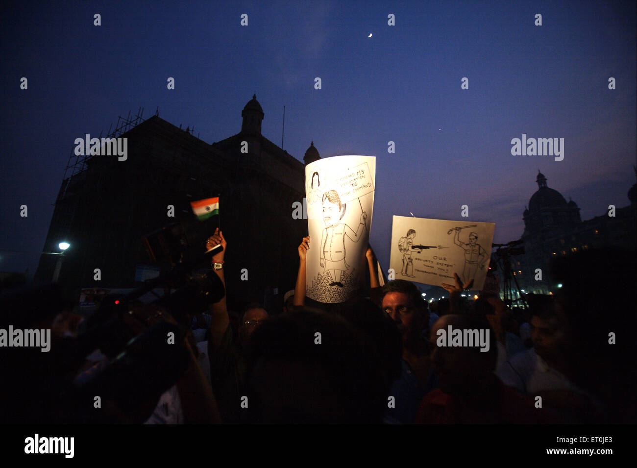 People holding placard cartoons chief minister Maharashtra Vilasrao Deshmukh protest terrorist attack 26th November - Stock Image