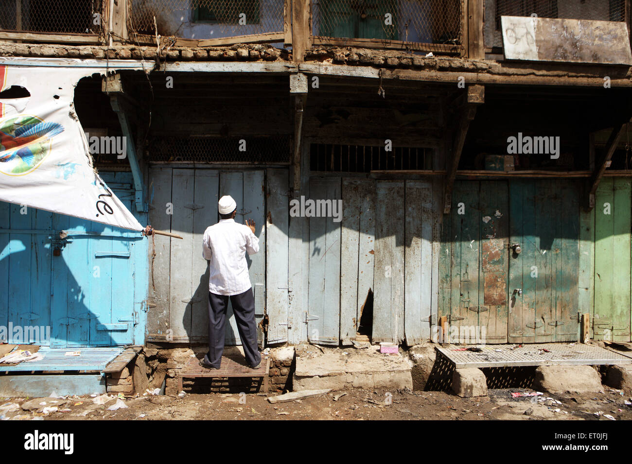 Shopkeeper monitoring losses to his property after bomb blast on 29 September 2008 in textile town of Malegaon ; - Stock Image