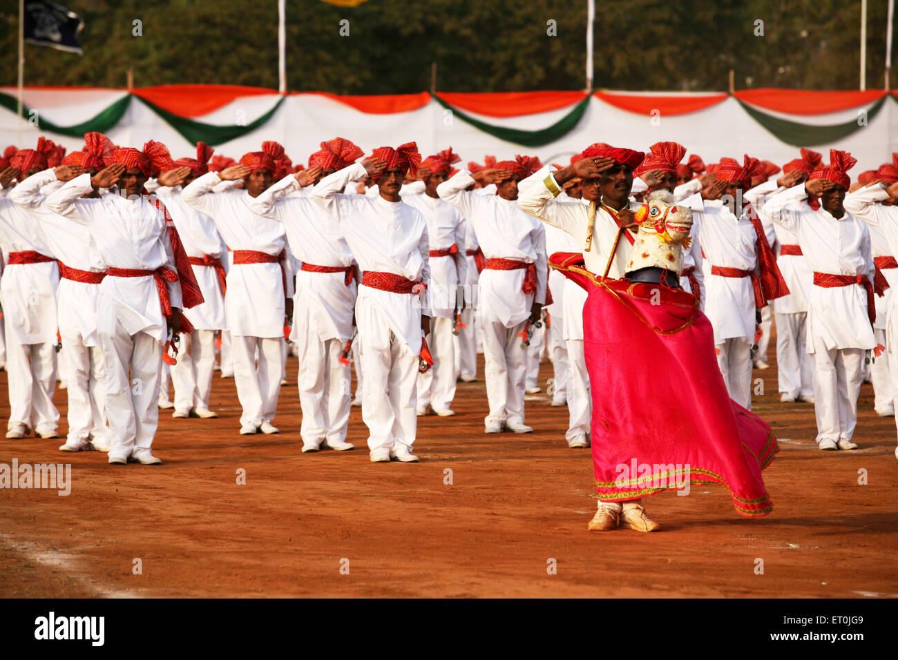 Police men traditional attire saluting performance Lejhim on 1 May Maharashtra foundation day ; Shivaji park ; Dadar - Stock Image