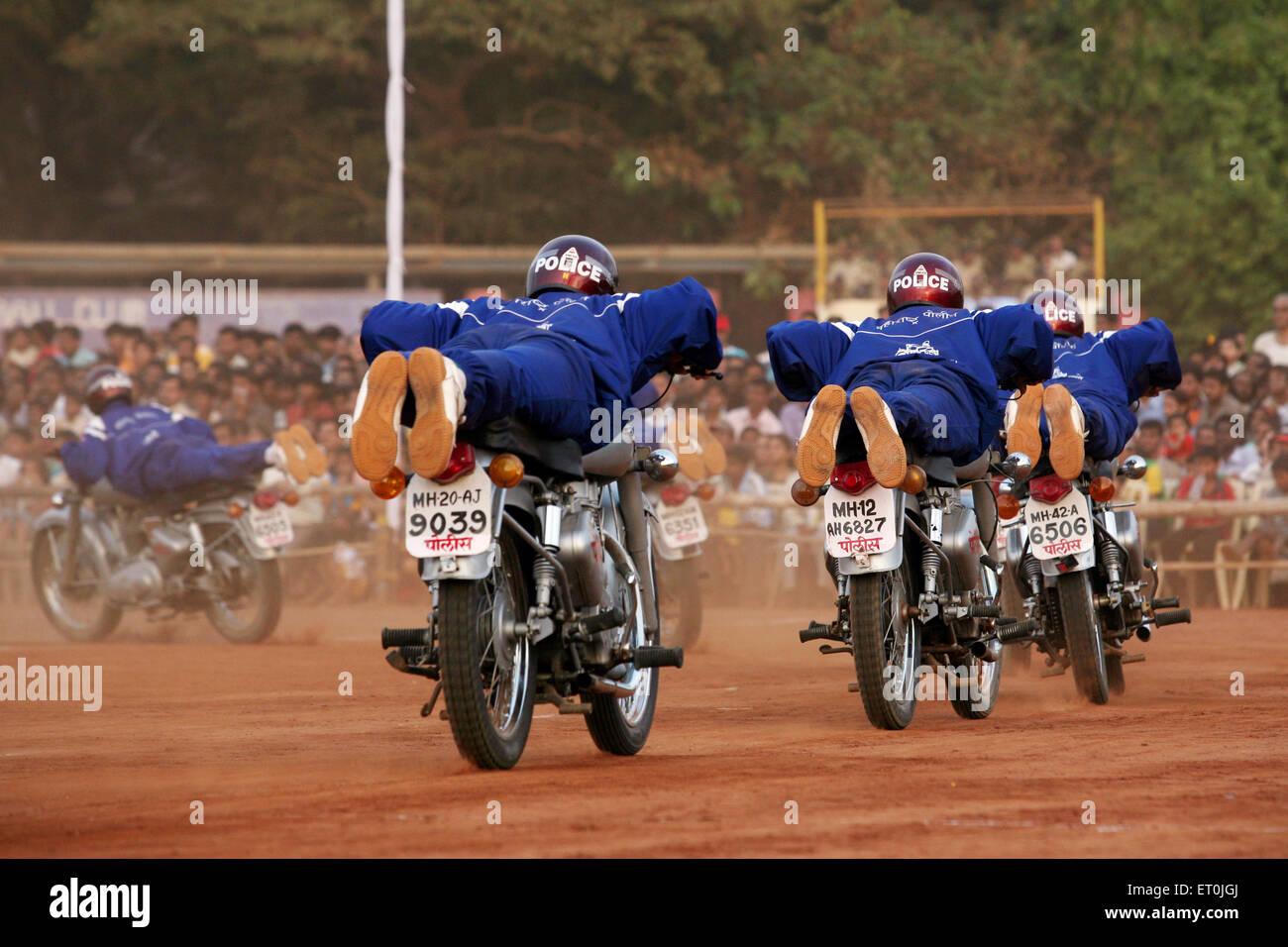 Police men performing stunts on motorbikes on 1 May Maharashtra state foundation day ; Shivaji park ; Dadar ; Mumbai - Stock Image