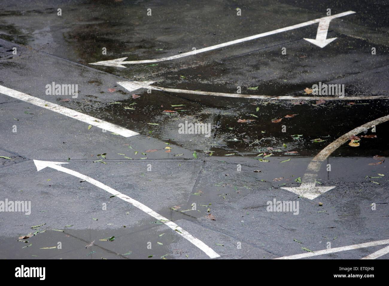 Different arrow indicators on the road in Bandra ; Bombay Mumbai ; Maharashtra ; India - Stock Image