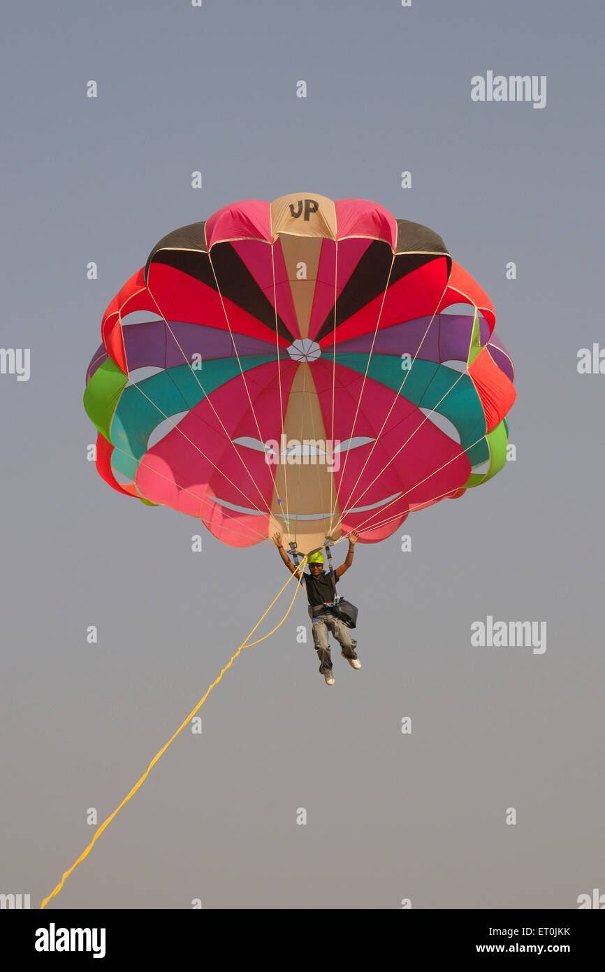 Paraglider doing stunt in sky ; Pushkar fair ; Rajasthan ; India - Stock Image