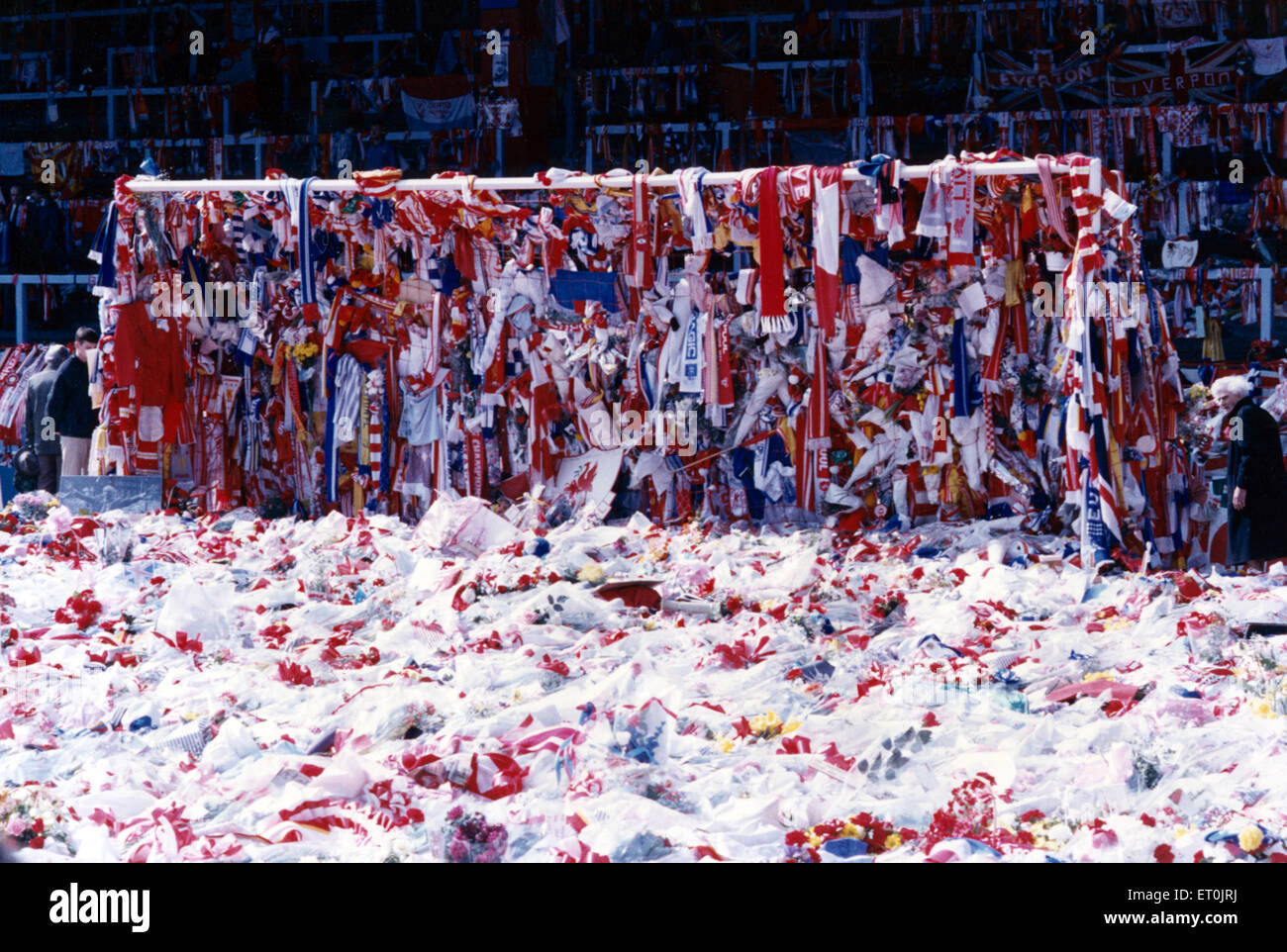 The goalmouth on the pitch at Anfield, covered with Liverpool and Everton scarves and flags as a mark of respect - Stock Image