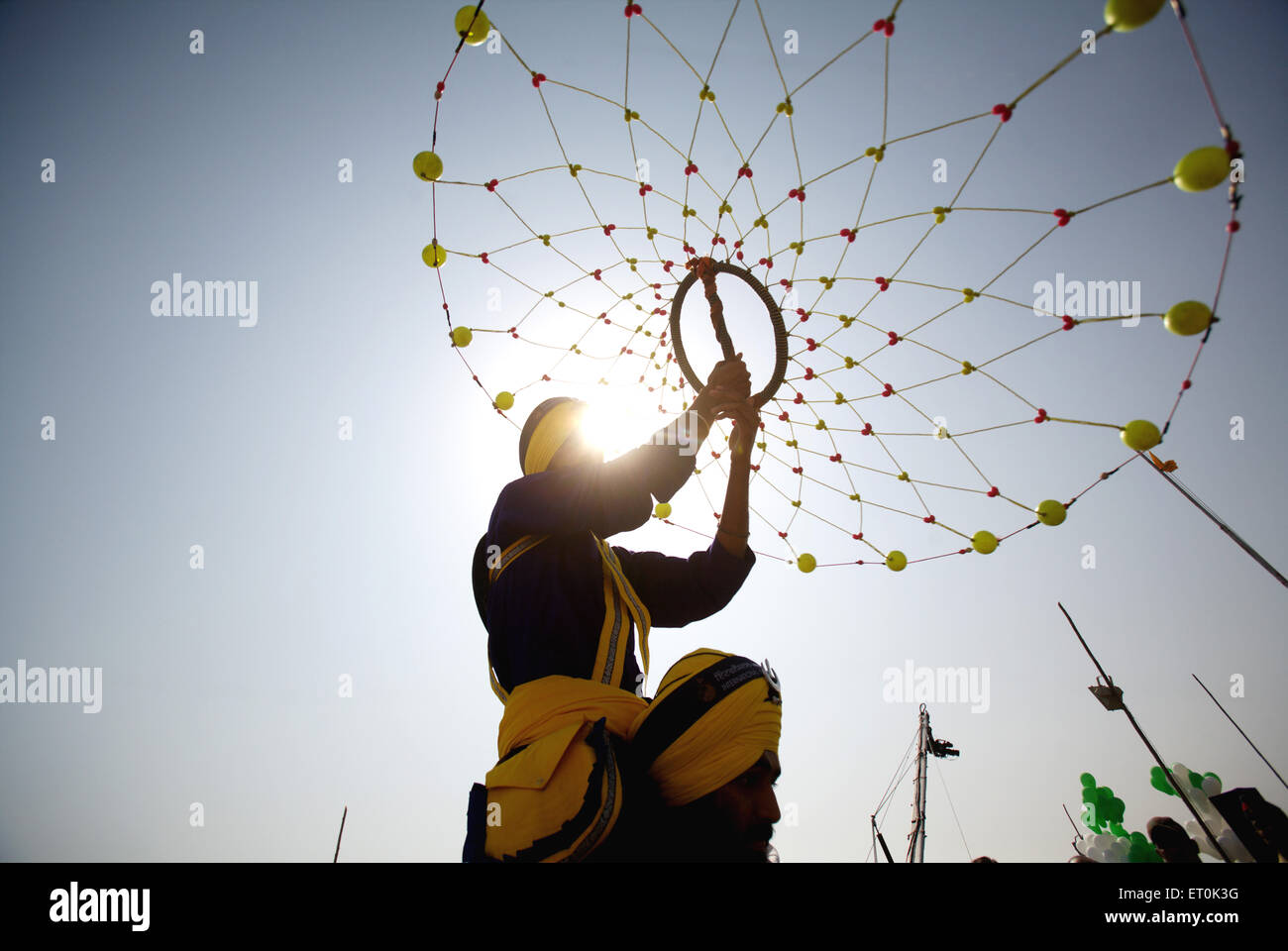 Young Nihangs Sikh warrior performing traditional martial art Gatka consecration perpetual Guru Granth Sahib ; Nanded - Stock Image
