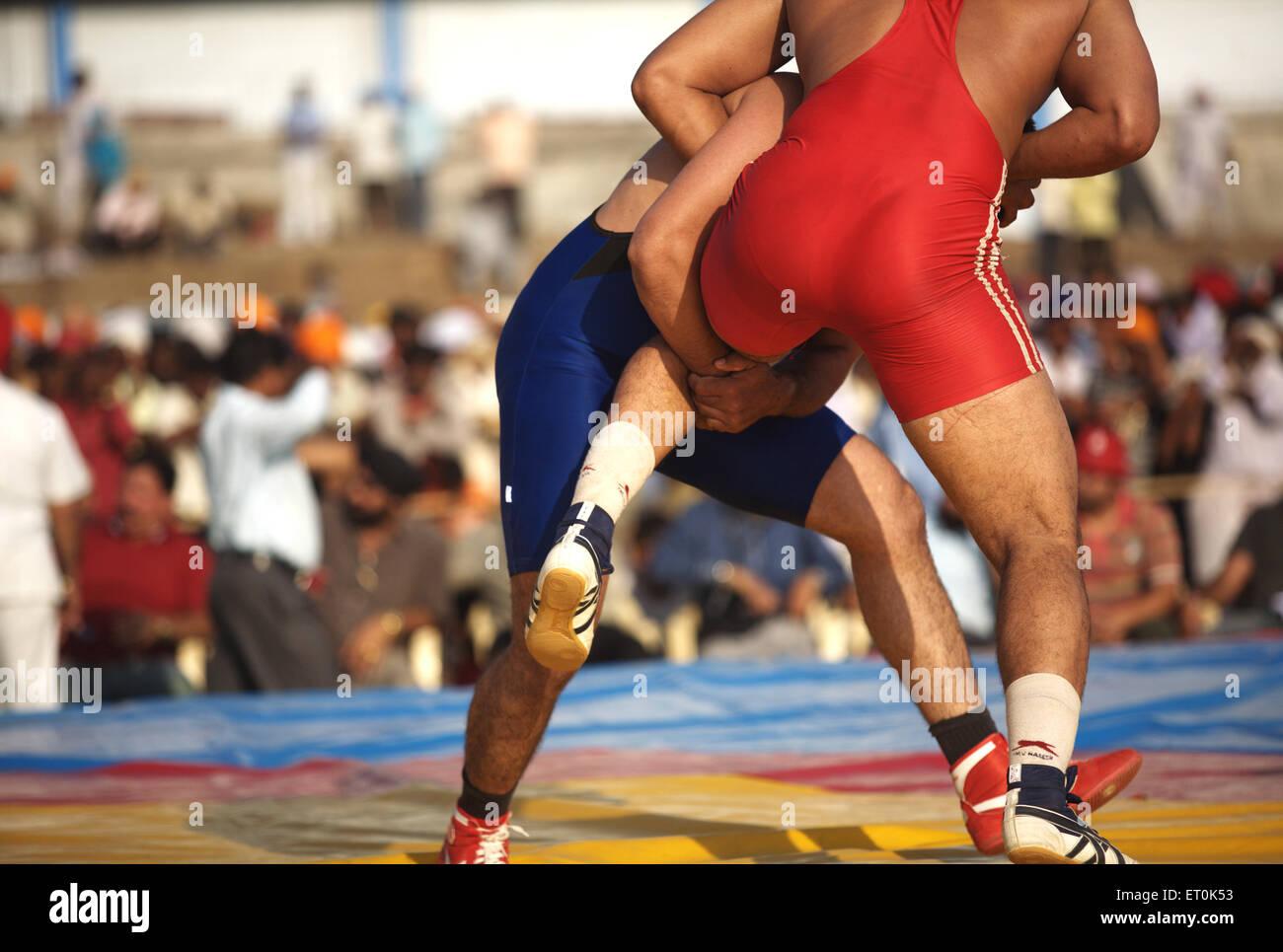 wrestlers from India Pakistan wrestling match ;Consecration perpetual Sikh Guru Granth Sahib Khalsa Sports ground - Stock Image