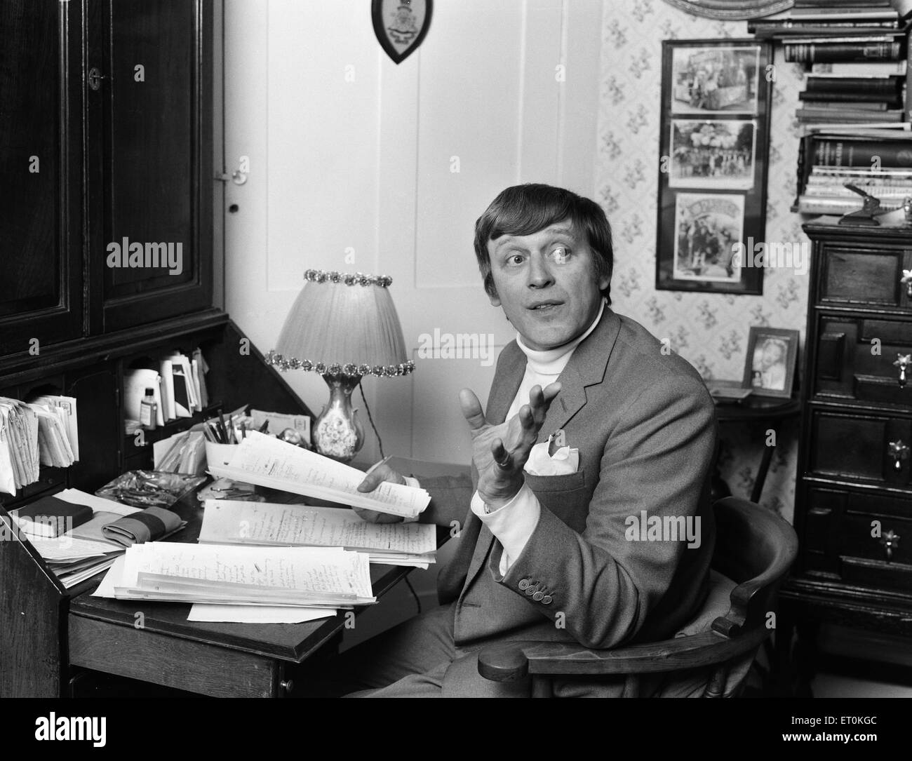 Jimmy Perry, Scriptwriter, pictured working on Dads Army scripts, at home in Westminster, London, 9th April 1969. - Stock Image
